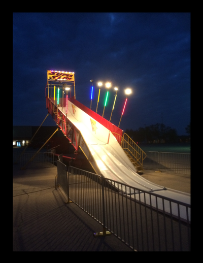 bumper hitch carnival slide for sale lit up at night