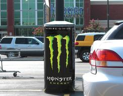 Communicate your brand message with a colorful wrap on a light pole base cover.