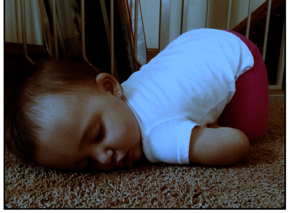 baby sleeping on clean carpet