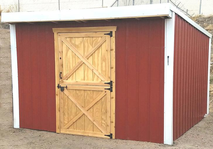 Red storage shed with Dutch door