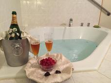Closeup of whirlpool tub with bottle of champagne, glasses and fresh berries in one of the whirlpool tub suites at the Wedgwood Inn, New Hope, PA