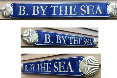carved qurterboard sign b.by the sea 6in x 48in