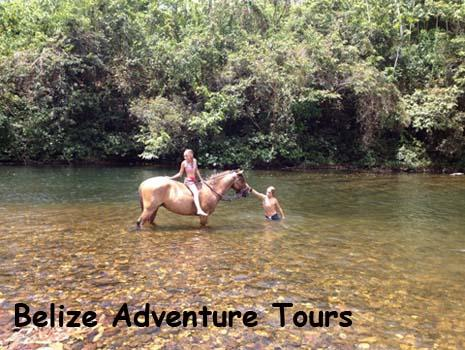 Two kids play in the river after a horse back ride in the jungle. Belize adventures abound.