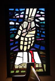 Word Of God Stained Glass Window featuring a hand coming down from the top above an open Bible with a red ribbon bookmark