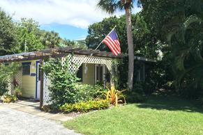 Canal Place Bungalow on Siesta Key. Pets stay free and have a yard. Sidewalk infront of rental.