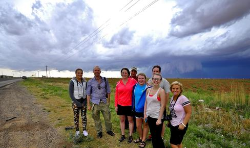 Happy Tour Guests in front of wall cloud