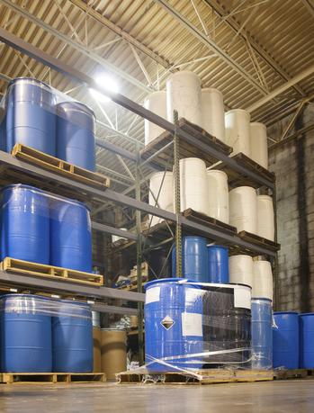 Picture of drums on pallets on racking in a warehouse