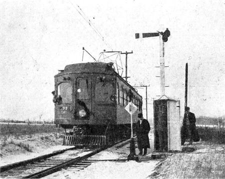 A Chicago, Lake Shore and South Bend wood-bodied interurban car at a siding, circa 1909.