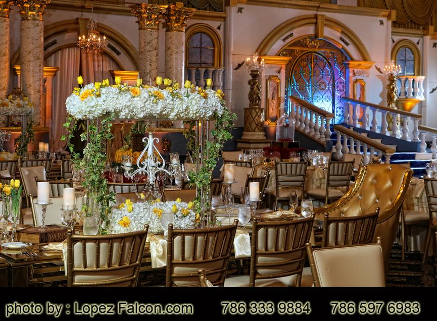 Centerpieces Tables Decorations Flowers Beauty & the beast quinceanera bella y la bestia quinceanera miami Lopez Falcon Quinces Photography escenario stage decor