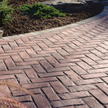 Driveway done in Permeable Paving stones in Herringbone pattern concrete bricks