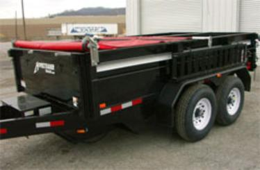 Manual pull style tarp system installed on a small dual axle trailer