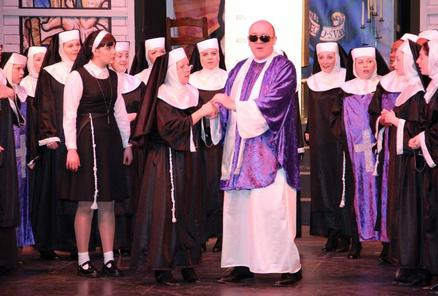Monsignor O'Hara (Mark Cooper) and the convent nuns