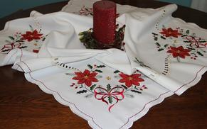 Christmas table toppers and table runners provide instant holiday decorations