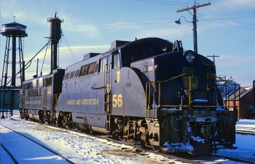 Two diesel locomotives of the Bangor and Aroostook Railroad, EMD BL2 No. 56 and EMD F3 No. 44, at Northern Maine Junction, February 5, 1970. Photo by Roger Puta.