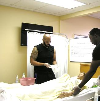 CNA Students and practice dummy