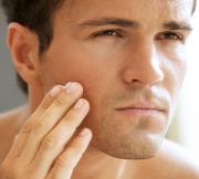Male applying anti aging cream, Pure Radiance Natural Skin Care Products