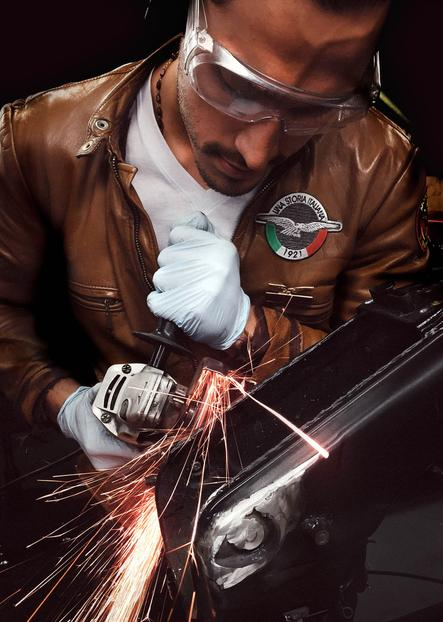 craftsman at work with sparks
