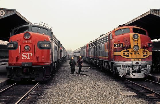 "LAUPT in March of 1971. Santa Fe's ""San Diegan"" is on the right, Southern Pacific No. 1 ""The Sunset"" is on the left. Photo by Drew Jacksich"
