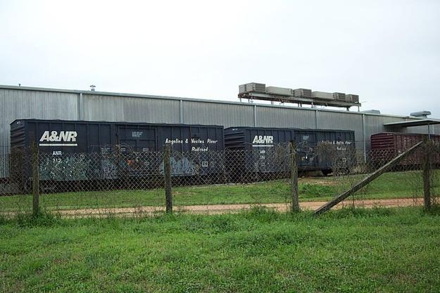 Two Angelina and Neches River Railroad boxcars are seen on a siding near Childersburg, Alabama. March 15, 2003.