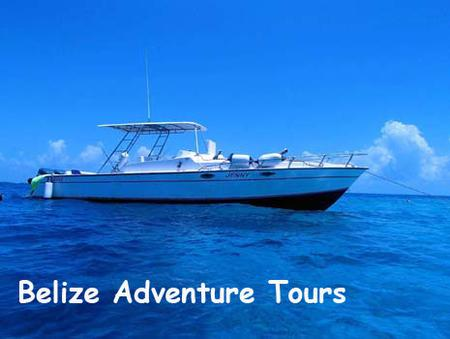 Our boat floats on the perfect blue waters near the Belize barrier reef. She is ready to take you on a Belize Adventure.