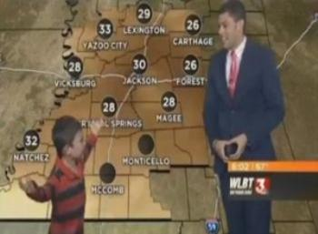 Amusing child Interrupts Weatherman