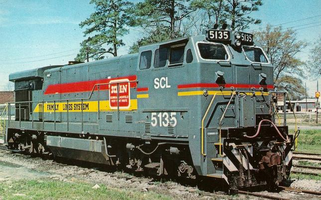 One of the order of ten new General Electric BQ23-7, Seaboard Coast Line 5135, is at Chadbourn, NC, April 6, 1980. The large cab is designed for full crew quarters eliminating the need for a caboose in some applications such as branch line service. Photo by Warren Calloway