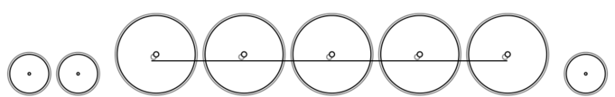 A diagram of the 4-10-2 Wheel Arrangement showing two small leading wheels, five large driving wheels all joined by a coupling rod, and one small trailing wheel. Front of locomotive at left.