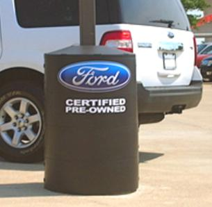 Poletector with graphic logo identifies dealership areas