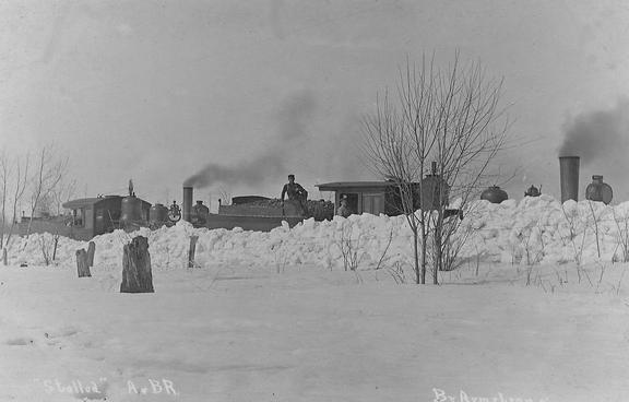 Snowbound locomotives of the A&BR at Arcadia, Michigan.