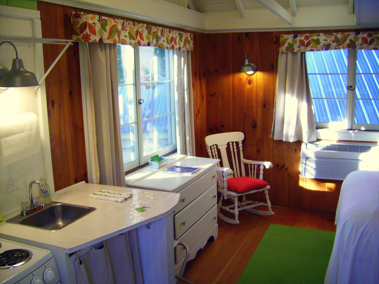 lake located shores cottage nh of lakefront meredith quiet waukewan on front the inc clean in rentals pollard cottages
