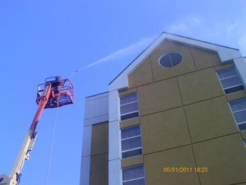 A1 Pressure Washing soft washing the EIFS of a hotel