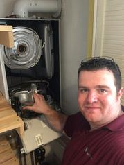 James Repairing a boiler in Grays