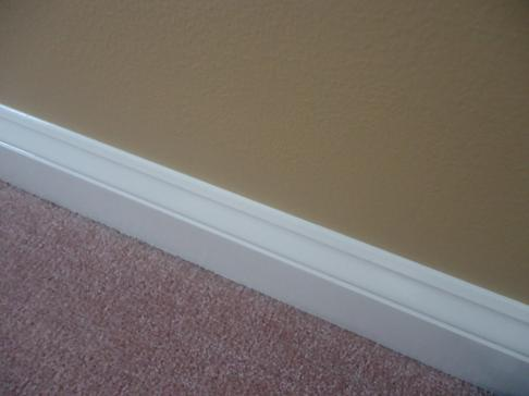 straight paint line on baseboard.