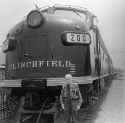 "A survivor of the ""Glory Days of Steam"" - the author: Burt C. Blanton - momentarily delays departure of the Clinchfield Railroad's special excursion train which is standing at the Marion, North Carolina Depot; scheduled to leave at 9:00 am on Sunday morning, June 10, 1979."