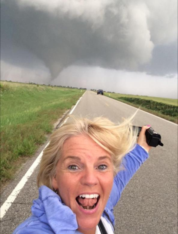 Extreme Chase Tours Storm Chasing Tours guest filming tornado behind her