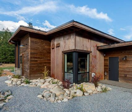 A mix of knotty Western Red Cedar and metal siding clad this rustic modern home in Eastern Washington