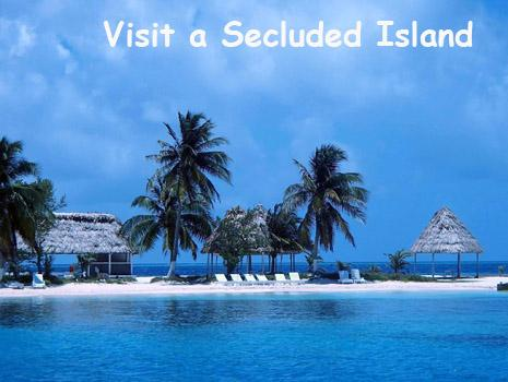 A tiny island on the Belize barrier reef dotted with palm trees and palapas. The island is surrounded by coral reefs teaming with tropical fish. Belize Vacation Packages Available!