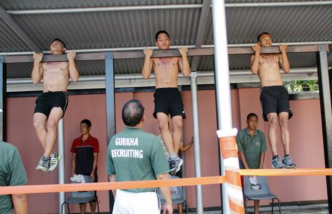 Potential Gurkhas doing pull-ups during recruit selection in Nepal