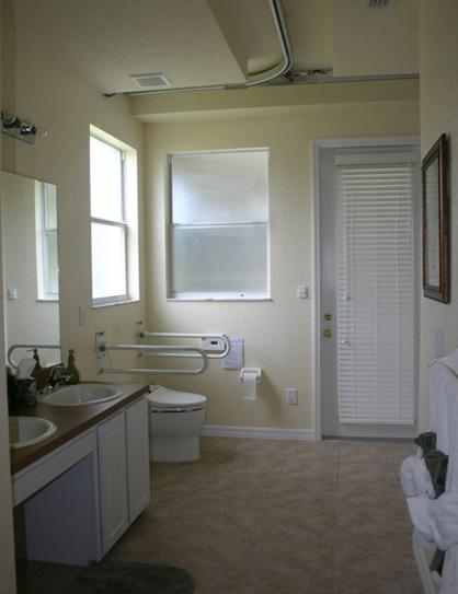 Accessible bathroom with wheelchair access to pool deck