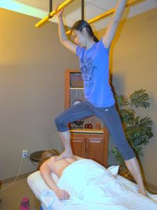 Picture of Jing Liu applying Ashiatsu Oriental Bar Therapy to Back