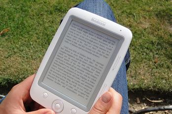 An ebook reading device held by a person