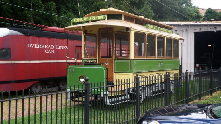 United Railways and Electric/Baltimore City Passenger Railway car number 417 at the Baltimore Streetcar Museum (front) and overhead electric line repair car 2187 (rear) posed in front of the south car barn on september 29, 2012.