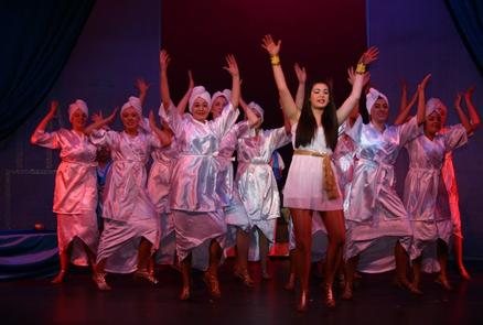 Amneris (Megan Postle) and ensemble dancing