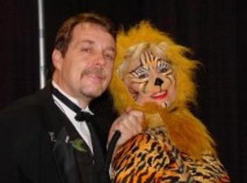 Magician Chicago as Ringmaster. Hire full face Tiger face painting