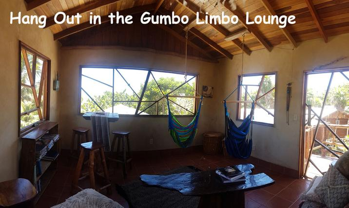 The lounge at Leaning Palm Resort is furnished with hanging hammock chairs, games, books and amazing 360 degree views from our elevated screened space. Perfect place to relax during you Belize vacation.