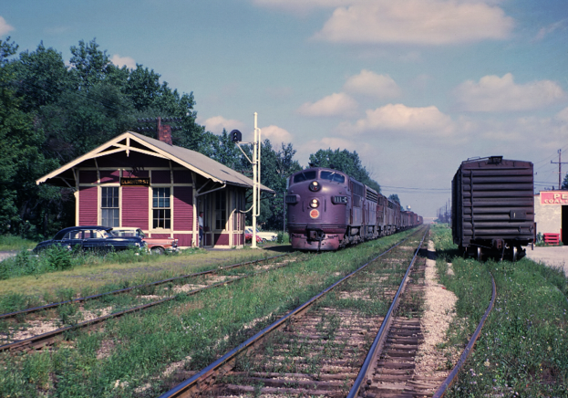 A CGW freight train passing through Elmhurst, Illinois, circa 1962.