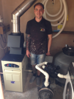 Gary with a newly installed swimming pool boiler in Essex