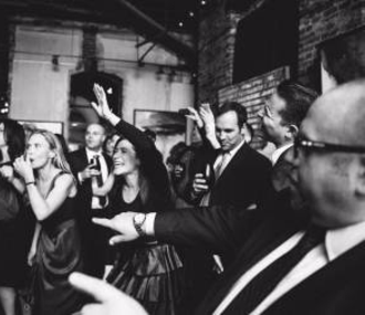 barn wedding dance party hands in the air