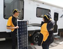 Thin flexible solar panels about to be installed onto a caravan