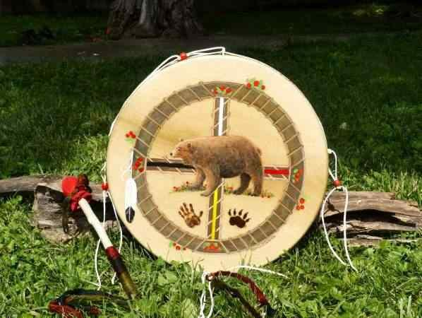 a beautifully painted and decorated thunder valley drums hoop drum